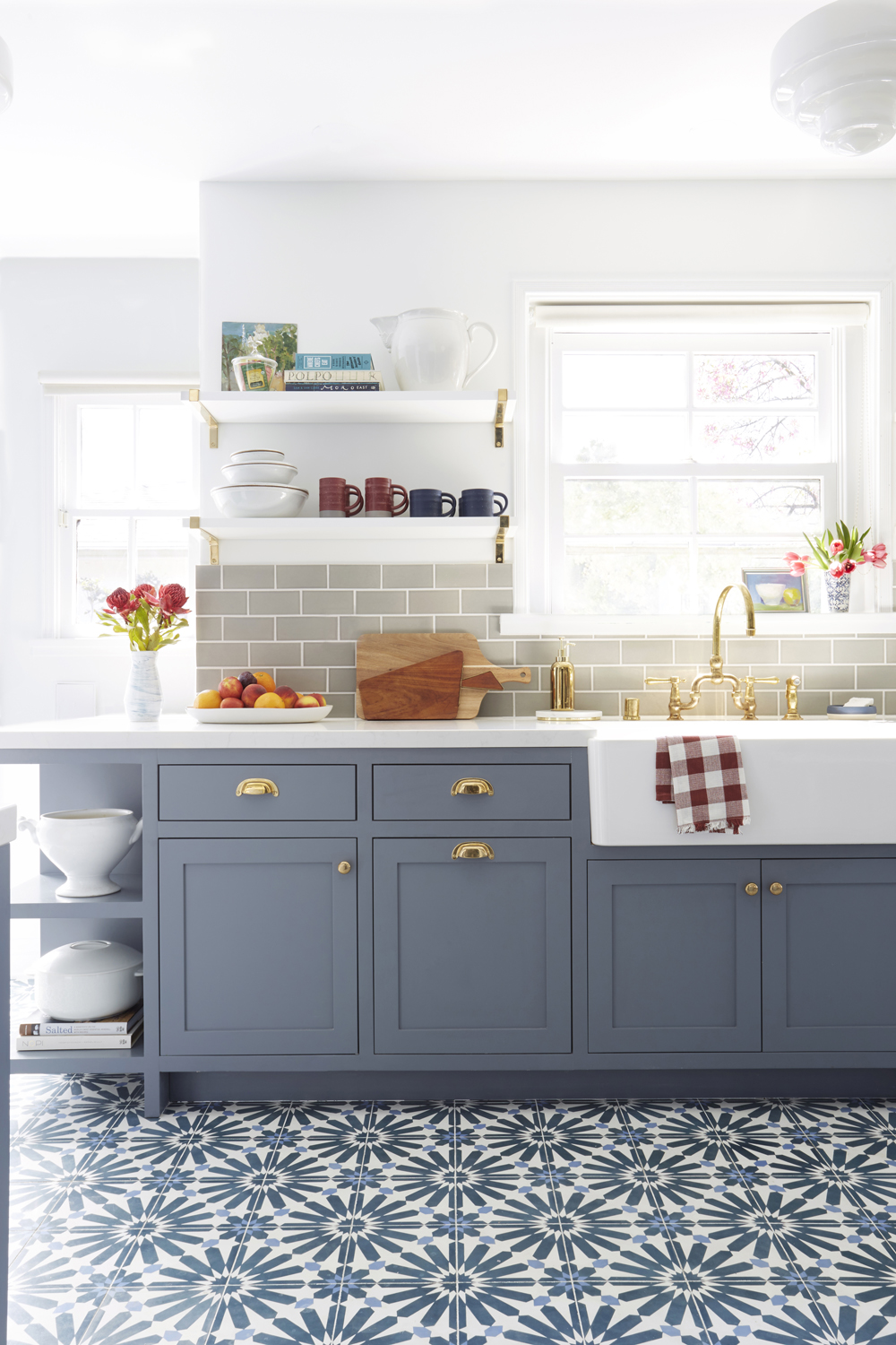 Beautiful medium blue kitchen cabinets and blue cement tile flooring. Come see 36 Best Beautiful Blue and White Kitchens to Love! #blueandwhite #bluekitchen #kitchendesign #kitchendecor #decorinspiration #modernfarmhousekitchen